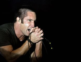 Trent Reznor's musical moments are always iconic. Here's our ranking of Reznor's ten greatest on-screen musical moments.