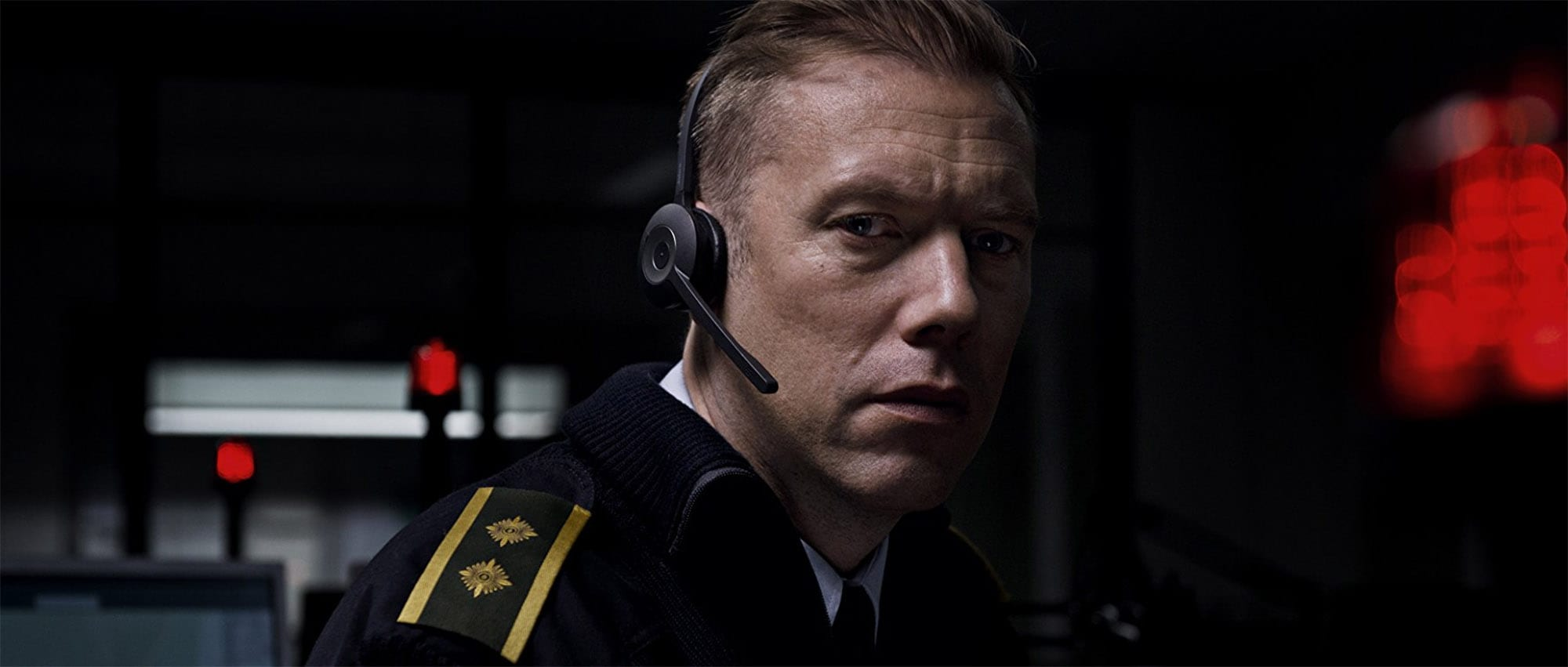 When a police officer is demoted, he expects a sleepy beat, until he answers a phone call from a kidnapped woman who then disconnects in 'The Guilty'.
