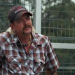 Joe Exotic, the subject of Netflix's 'Tiger King' docuseries is in self-isolation after possibly contracting coronavirus in prison. Here's what we know.